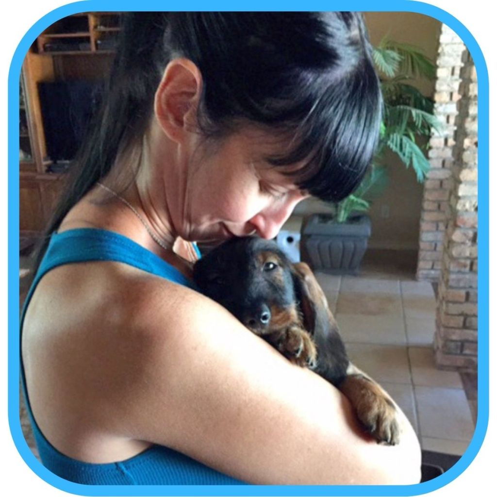 Shannon Cutts of Animal Love Languages with wire-haired dachshund puppy Flash Gordon